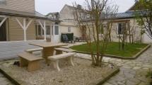 Maison: vie de plain pied avec garage et jardin à 600 mètres de la plage